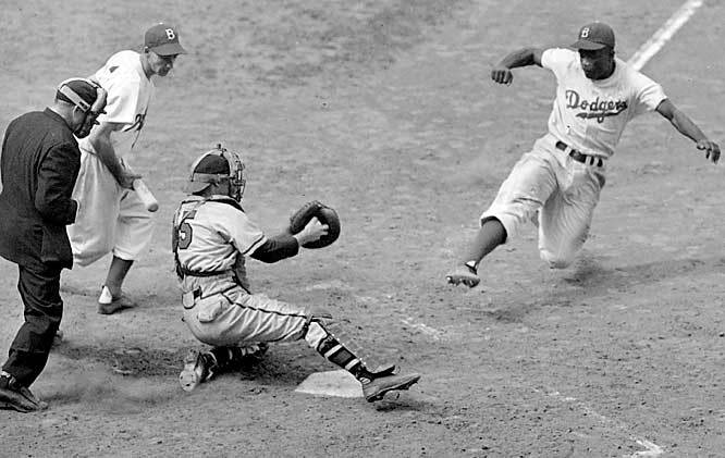 Jackie Robinson steams home against Bill Voiselle and catcher Bill Salkeld during a 1948 Dodgers-Braves game. Sunday marked the 65-year anniversary since Robinson broke baseball's color barrier. (AP) GALLERY: Jackie Robinson Retrospective ROTHSCHILD: Robinson changed baseball and nation
