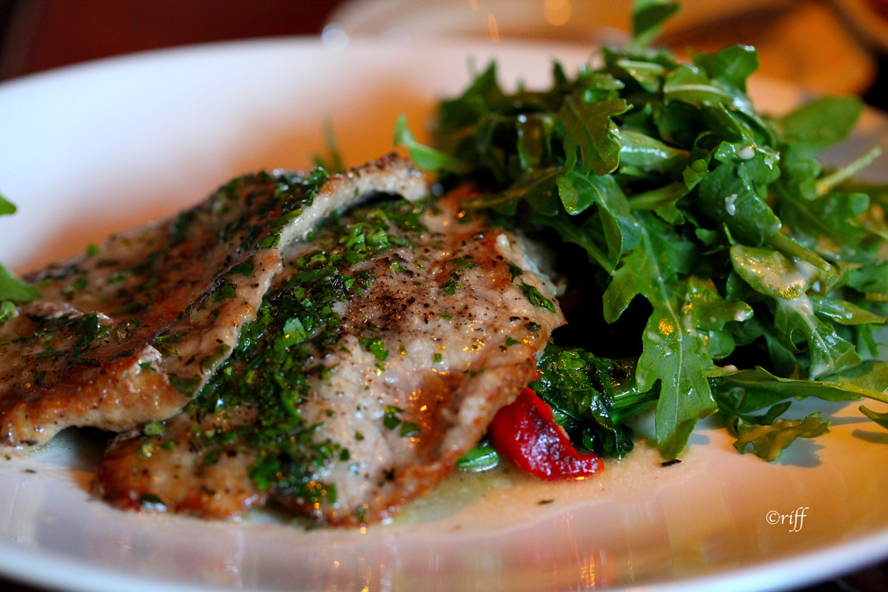 Veal Scallopini with lemonIngredients:2 pounds veal scallopini1 C all purpose flourSalt & fresh ground pepper, to tasteOlive oil and butter1 1/2 C chicken stock1/2 lemon, juiced, and the other half sliced thinly for garnishChopped parsley for garnishDirectionsPour the flour onto a plate, and season with salt & pepper. Dredge the scallopini in the flour and shake off the excess, set aside.Melt butter and olive oil together in  a skillet over medium heat. Add scallopini to skillet and brown on both sides. Set aside until all the veal has been cooked.After the veal has been removed from the pan, add the chicken stock to the pan over high heat and scrape the bottom of the pan to loosen all the brown bits. Cook until the liquid has been thickened.Add one tablespoon of butter, lemon juice and parsley to the sauce. Stir over high heat for another 5 minutes or so.Pour sauce over veal, Garnish with the thinly sliced lemons and parsley, and serve.