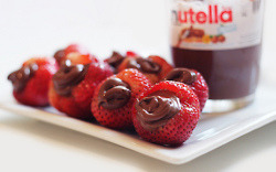 Strawberry + Nutella = Happiness (via letthemeatc8ke)