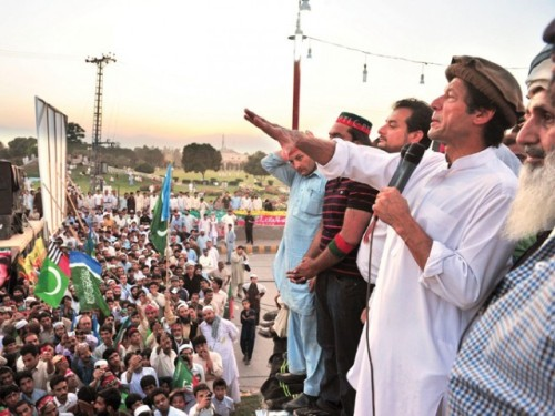 "Pakistan Tehreek-e-Insaf (PTI) Chairman Imran Khan making a speech to members of the Jamaat-e-Islami (JI) and Sipah-e-Sahaba Pakistan (SSP) - a banned terrorist organization in Pakistan. The flags with the blue stripes belong to the JI. The red, green, black and white flags belong to the SSP.  ""It appears that the PTI, instead of peeling away extremists, is pandering to the hateful agendas of Pakistan's Islamist and hyper-nationalist lunatic fringe."" THE READ - Imran Khan: Engaging Delusion"
