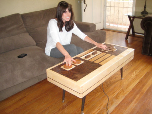 This functional Nintendo Controller Coffee Table can be yours for $3,5000…hurry up only 1 left Nintendo Controller Coffee Table by TheBohemianWorkbench (via Etsy)