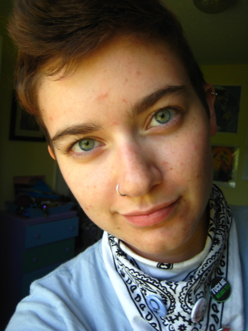 [Image: gratuitous photo of queerio19 - a white person with short brown hair, blue/green looking eyes, and a nose ring]. they are half-smirking at the camera and are wearing a light blue shirt and a white bandana with several buttons from The Radical Uprise] mckeegles:   Goooood afternoon! I'm off to [be late to] the Day of Silence photoshoot. Woo! Actually I'm about to miss my bus. Catch you on the flipside. xoxo kp  Introducing my amazing partner that I'm constantly rubbing in everyone's faces because I'm so darn enamored #sorrynotsorry  hey that's me! <3 I take all the cute photos for the cutie I reblogged this from ;]