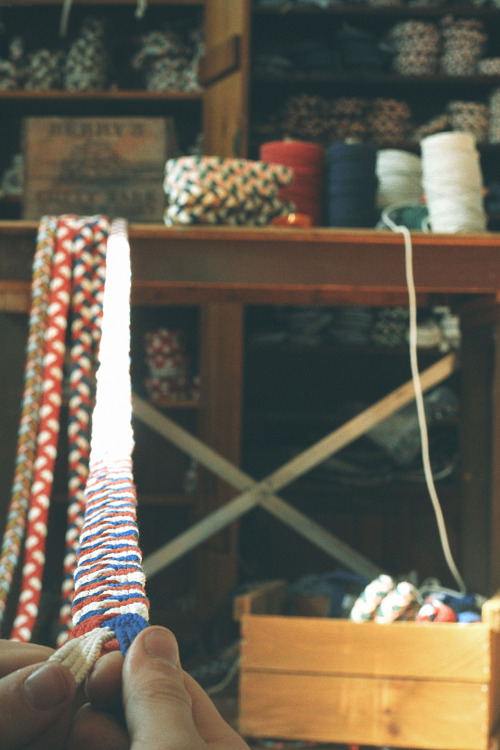 "kieljamespatrick:  Daily sailing belt line up at the factory. Mom swung by to visit and called our fastest ""top braider"" the ""Master Braider"". Everyone froze in silence… I don't think she realized how bad that sounded. :-("