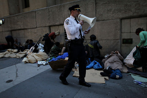"thepeoplesrecord:  Four occupiers arrested at OWS sleep-in by Stock Exchange, NYPD says sleep-ins illegal The order came around 6 a.m., after about 100 people spent the night sleeping near the stock exchange, most of them on Nassau Street. ""Sitting or lying down on the sidewalk is not permitted,"" a police captain announced. ""Anyone who is sitting or lying down must now get up or be subject to arrest."""