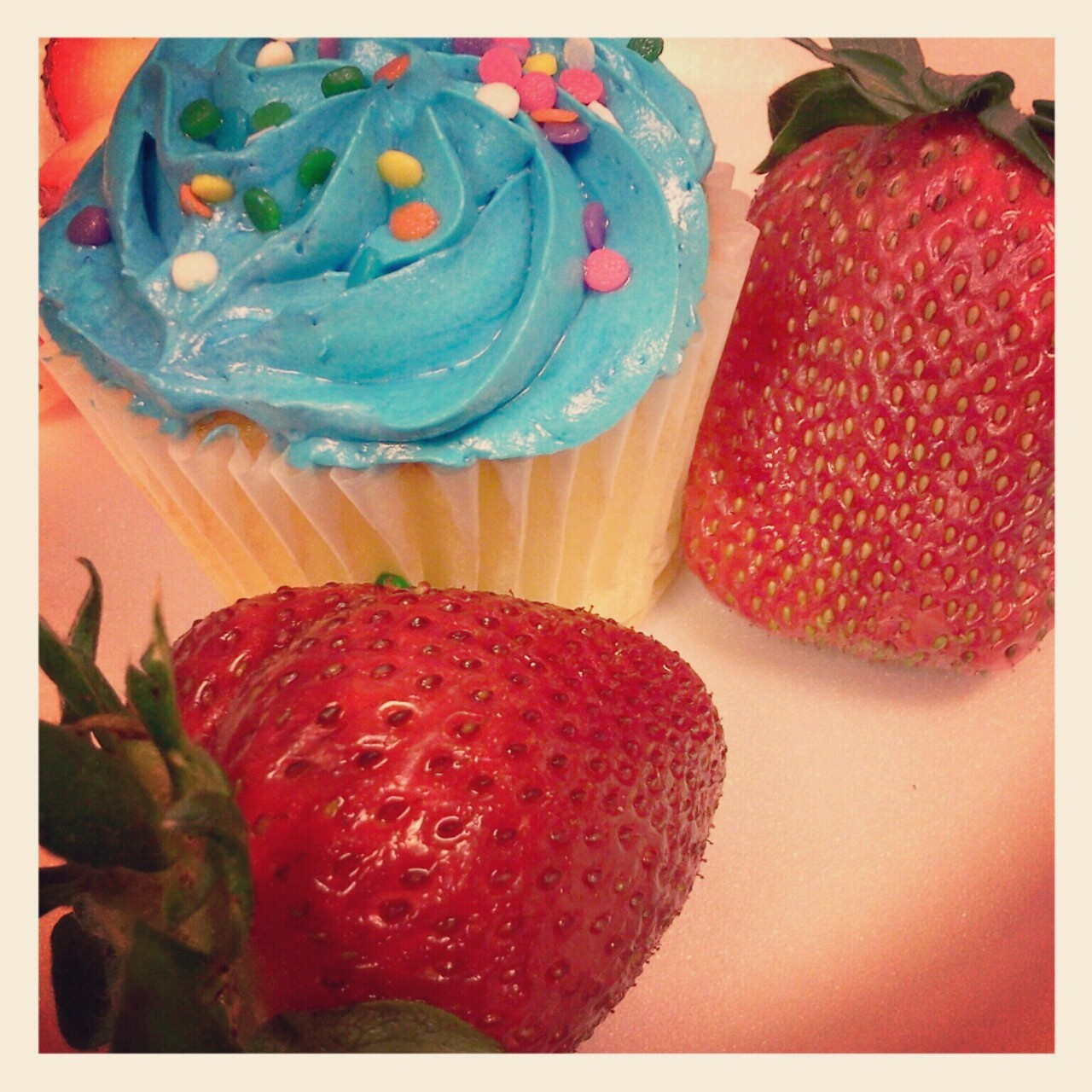 Cupcake and cupcake-sized strawberries. Receptionist's birthday today. ^_^