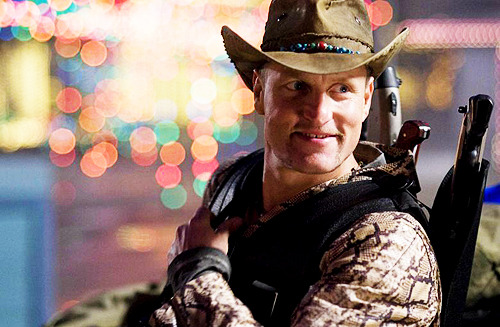 "Woody Harrelson had input into the wardrobe for his character, Tallahassee. ""I never worked so long and hard on an outfit in my life,"" the actor has stated. ""What this guy wears is who he is. You want to get a sense of this guy as soon as you see him. So I pick out the necklaces, the sunglasses. But the hat? The minute you see that on Tallahassee, you buy him. He's real. And he's got a real cool hat"". Harrelson's choice of headwear for Tallahassee came not just down to style, but also to his environmental passions: the distinctive hat is handmade in Brazil by a company called The Real Deal using recycled cargo-truck tarps and wire from old truck tires."