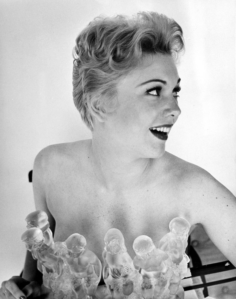 life:  Kim Novak, 21, poses with crystal figurines in 1954. The Chicagoan started off as Miss Deepfreeze for a local refrigerator company, and was recruited by Columbia Pictures to be a more manageable replacement for Rita Hayworth. (J. R. Eyerman—TIME & LIFE Pictures/Getty Images) See more photos here.