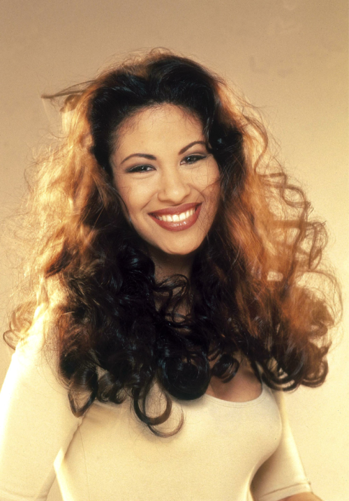 "thinkmexican:  Happy Birthday, Selena! Selena Quintanilla was born on April 16, 1971 in Lake Jackson, Texas, the youngest daughter of Abraham and Marcella Quintanilla. Known by her fans as ""La Reina,"" meaning the ""The Queen,"" Selena remains a vital figure in the Mexican community. 17 years after her death, her music and public image is still very much alive. Selena was tragically killed on March 31, 1995. Today would have been her 41st birthday."