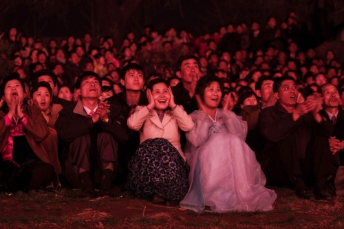 Photo of the Day Pyongyang, North Korea: North Koreans watch a fireworks display along the Taedong River to celebrate 100 years since the birth of the country's late founder Kim Il-sung. (David Guttenfelder / AP Photo) See more Photos of the Day