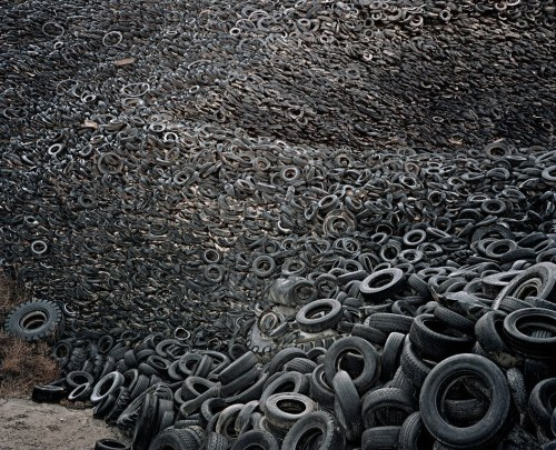 thisisnotsustainable:  The Oxford Tire Pile in Westley, California, photographed by Edward Burtynsky. 40 acres, 7 million tires, all in close proximity to the California Aqueduct.  Putting an end to the site took $1.2 million taxpayer dollars, and no complete closure plan has been submitted by the responsible parties.