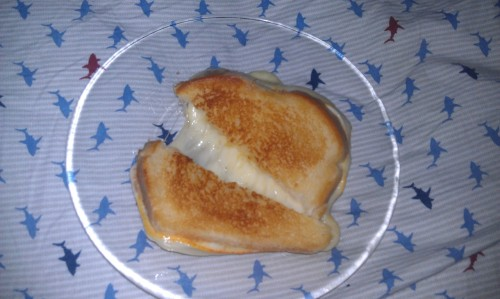 Happy Belated National Grilled Cheese Day courtesy of my BF =) The BEST grilled cheese sandwich I have EVER tasted.  No lie. Italian white bread.  Clarified butter.  Havarti.  Muenster. O man, should've seen how stretchy the cheese combo was.  Pulled the halves two feet apart and it still wouldn't separate.  Mind-boggling. Washed it down with some ViVi taro bubble tea. Amazing.