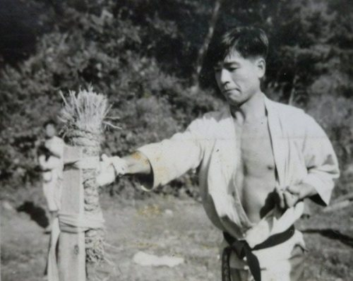 Teruyoshi Okazaki hitting a makiwara. Teruyoshi is the brother of Shotokan master Teruyuki Okazaki, the founder of the International Shotokan Karate Federation (ISKF). Both brothers are direct students of Master Gichin Funakoshi.
