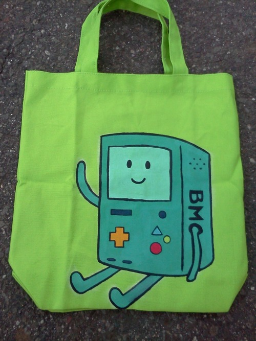 http://www.etsy.com/listing/97716683/adventure-time-hand-painted-bmo-tote  New design went up on my Etsy store today! B-MO! Not sure how I feel about this design, but I have an abundance of green totes I needed to do something with. :x   If you have any ideas or suggestions please feel free to let me know :]  (Obviously I don't own Adventure Time, yada yada disclaimer nonsense. I just really love this show!)