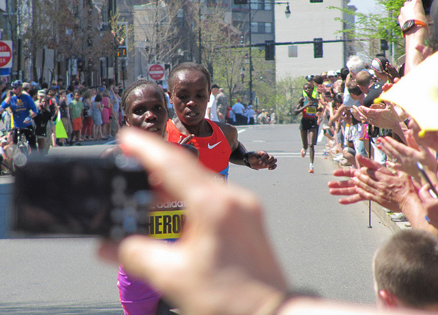2012 Boston Marathon, mile 24. Beacon St., just east of Coolidge Corner. I had a nice photo of the women's race leaders ready to go until another spectator stuck a camera in front of my face. Kenya's Sharon Cherop and Jemima Jelagat ran next to each other during the final several miles and Cherop ended up beating Jelagat by a mere two seconds.