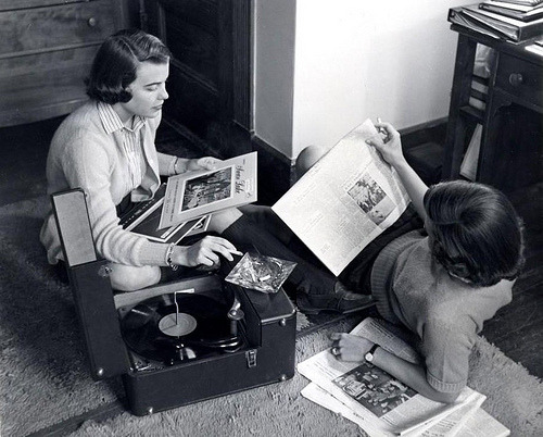 fuckyeahvintage-retro:  Girls relax with records & cigarettes in their dormitory. Arkansas, 1954.