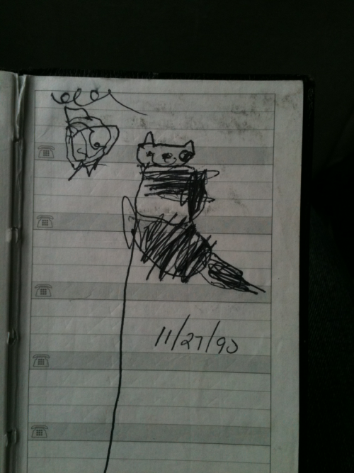 One of my earlier works. I was 4 and drew our cat Napoleon stuck in a tree. Don't worry, he came down.