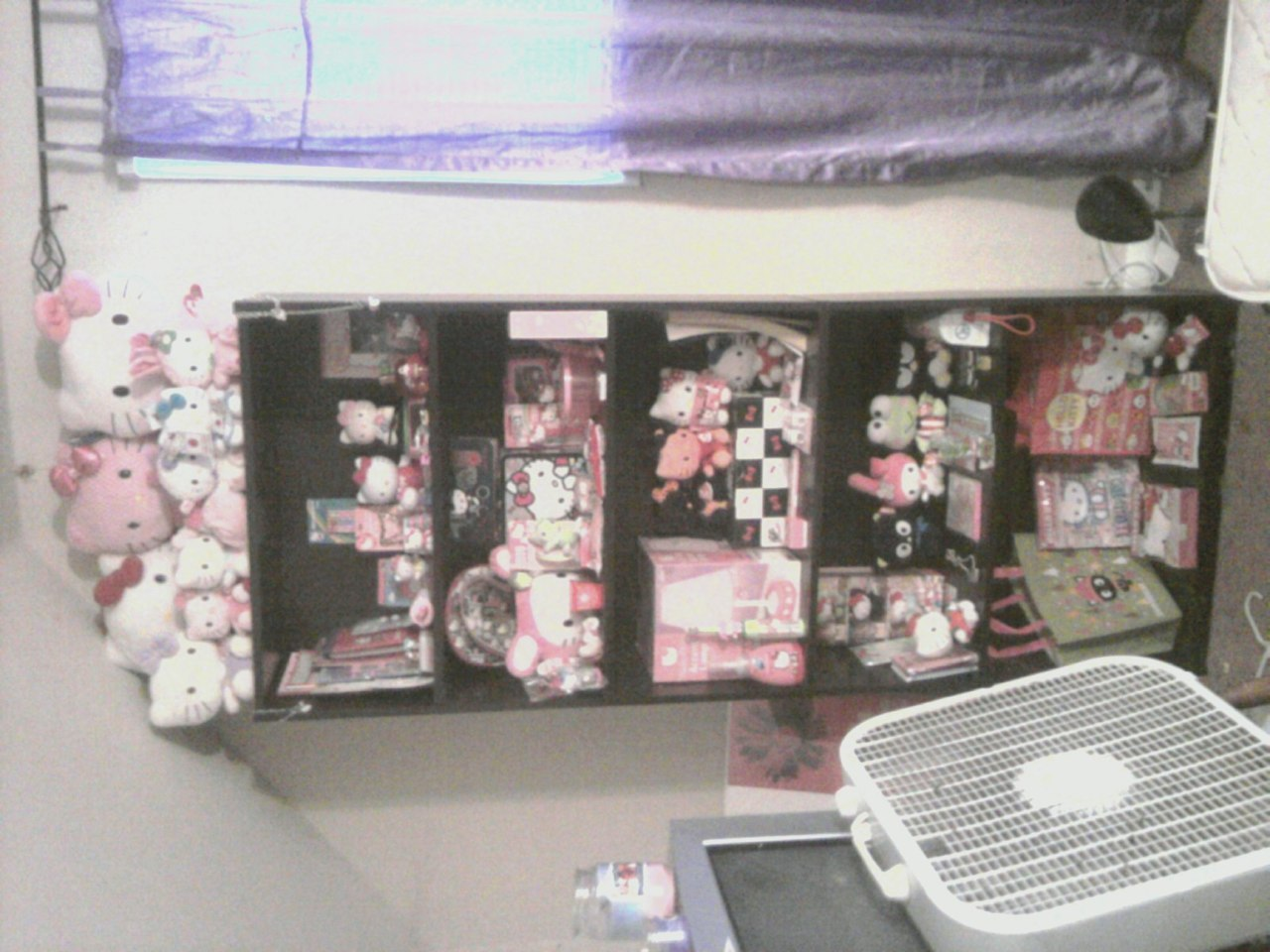 My Hello Kitty collection C: Not all of it would fit on the book shelf >.<