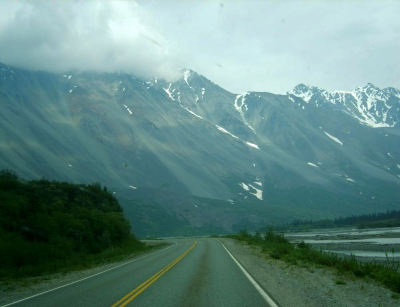 "Somewhere in Alaska, 2003. I snapped this photograph when I was nine years old, while traveling down some Alaskan highway in an RV with my parents, brother, and grandmother. Summer of 2003 was the time of our ""Great Alaskan RV Family Adventure."" Tons of incredible childhood memories resurrect within my consciousness when I glance at this snapshot."