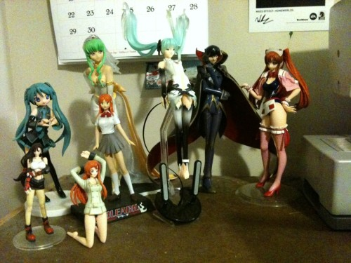 And here is my sad but deeply cherished figure collection. Complete with Kagamine-HatsuneMiku, Tifa Lockhart, Orihime Inoue, Schoolgirl Shirley, Wedding C.C., my Append Miku from Crypton, Zero/Lelouch vi Britannia, and Swimsuit Shirley!! Everyone here (sans kagamine and lelouch) I havecosplayed. One day I will own all the figures I have cosplayed!!! But I still have a ways to go. I'm already 6 figures behind or so. ;_;