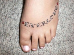 "footattoos:  When my husband and I started dating, he played Everlong for me and said ""I've been saving this song for a special girl"". Eight years later, we have two kids and still love us some Foo Fighters. He has ""Everlong"" engraved in his wedding ring & I have it tattooed on my foot. We saw the Foos last October at the Forum in LA, a day before our sixth wedding anniversary. I'm pretty sure Dave was singing Everlong to us. ;)"