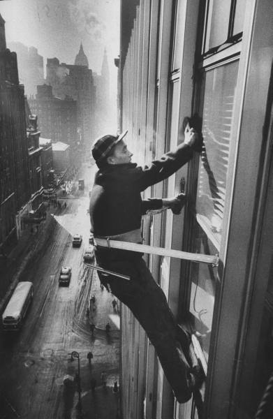 Window cleaners cleaning high rise on Madison Avenue. by Walter Sanders