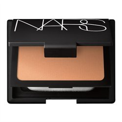 "Femme Fetch: Nars Cosmetics Powder Founation At this point, we are all aware of the Sheer Glow and Sheer Matte foundation formulas from the Nars Cosmetics line. You would have had to have been completely shut off from the beauty scene the past few months to have not heard the buzz or hype surrounding the Pure Radiant Tinted Moisturizer.  But I am hear to tell you that the Powder Foundation from Nars is amazing and is usually my go to daytime foundation. I actually find that alot of people shy away from powder formulas. For us oily girls, powder is an obvious choice over wrestling with liquids that claim to finish matte.  This particular foundation from Nars ,unlike the ""Sheer"" ones, offers a SPF; it's only 12, but that's better than nothing. I also find that I get good coverage that is far more natural than liquid plus no need to set with powder. Femme fatales are always on the go which works with this foundation because of it's compact packaging. This foundation can serve as a setting powder for your liquids also. Remember that versatility is key.  So Femme!!!!"