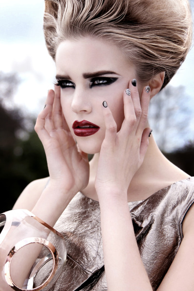 karlapowellmua:  My Latest Make-up work Published for C-Heads Magazine- Issue 28. Find out how and what I used to create this High Fashion make-up look…     This photo-shoot was around the theme 'Magnetize' which I am happy it's been published in C-Heads magazine. The brief giving to me by the photographer on the make-up was focus around metallic colours hence the title of the shoot- 'Magnetize', so I wanted to create an element of this in the makeup. Framed eyes with black with a silver streak through the eye lids, the eyebrows being well defined .The lips are blood red with a hint of black on the outer corner to add dimension. Finally the face was a matte and pale look with natural looking cheekbone definition. The nail look in this shot which I LOVE was inspired by the metallic 2012 trend with rhinestones, texture and detailed design.    Make-up I used:   Skin Care:   *Simple Cream Cleanser, Eye Brightening cream  *Origins Mr Bright Serum   Makeup Brushes:   *Sigma Beauty & Illamasqua   Base:    *Kryolan Ultra Foundation in TV White  *Illamasqua Cream Pigment in Hallow  *Translucent powder  *MAC Cream colour base in Shell  *No 17 Eye Dazzle pigment in 'Star Crossed'  *Look Beauty bronzer-Make me blush in Shade 'Sculpt'  *VIVO baked Bronzer in Shade 'Sun Kiss'   Eyes:   *Urban Decay Glide on pencil in 'Gun Metal'  *Look Beauty Long Lasting eyeliner in 'Graphite Grey'  *MUA Cosmetics Intense coloured eyeliner in 'Jet Black'  *FashionistA gel eyeliner in Silver & Black  *FashionistA mono eyeshadows in 'Frozen','Silver Lining','Steel' & 'Black Out'  *Shu Eemura gel eyeliner in 'Black'  *VIVO false eyelashes in 'Full on'  *Look Beauty mascara in 'Stretch Factor'   Lips:   *MUA Cosmetics Shade 13 lipstick  *FashionstA gel eyeliner in black  *OCCCosmetics Lip tars in 'Primary Red'   Karla  X   Magentize  Photography Faye Sampson (fayesampson.com)  Models Alexandra & Liza @ Premier Models  Make-up Karla Powell Hair Micky Kastly  Nails Chelsea Dagger  Stylist Aliya Zaidi  Stylist Assistant Zain Khan  Photography Assistant Stuart Berham