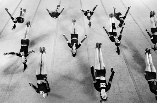 timelightbox:  The Oregon acrobatics and tumbling team. When photographer Holly Andres visited the University of Oregon acrobatics and tumbling team to shoot the young athletes at practice, she wanted to avoid the tropes of cheerleading photography. See more here.