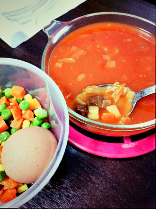 Borsch soup with beef pieces, mixed vegetables and hard boiled egg A pretty simple meal, not too much hassle. The Borsch soup is from Campbell, so all I did was add half a can of water and heat it up. Still yummy though:)