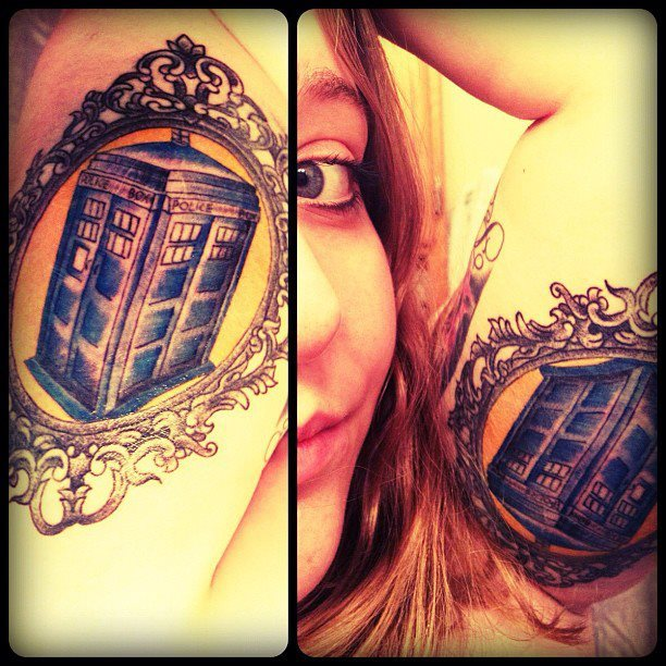 fuckyeahtattoos:  And the Tardis is finally colored in and complete! By Mohawk John @ Three Kings Tattoo in Brooklyn.