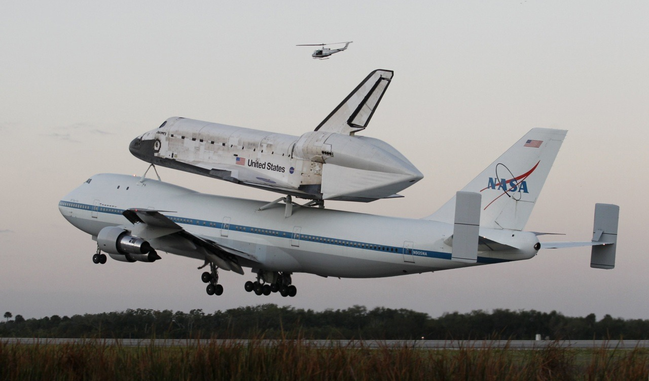 The space shuttle Discovery, attached to a modified NASA 747 aircraft, takes off headed for its final home at The Smithsonian National Air and Space Museum's Steven F. Udvar-Hazy Center in Chantilly, Virginia, from the Kennedy Space Center in Cape Canaveral, Florida April 17, 2012. [REUTERS/Joe Skipper]