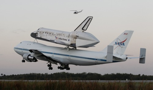 reuters:  The space shuttle Discovery, attached to a modified NASA 747 aircraft, takes off headed for its final home at The Smithsonian National Air and Space Museum's Steven F. Udvar-Hazy Center in Chantilly, Virginia, from the Kennedy Space Center in Cape Canaveral, Florida April 17, 2012. [REUTERS/Joe Skipper]