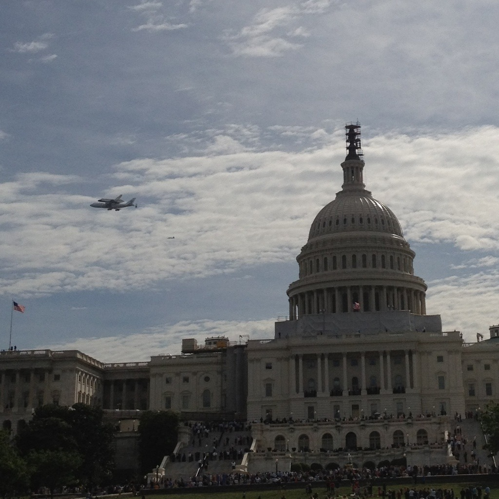 shortformblog:  The Space Shuttle Discovery, chillin' over the Capitol. The shuttle, decommissioned last year after a long career with many miles logged, is flying to the Smithsonian National Air and Space Museum to become a part of it. (shot by @DaveStroup, ht @ProducerMatthew)