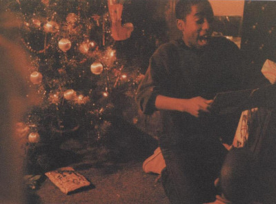 tupacshakurblog:  Tupak Shakur - Christmas Day, Rare photo.
