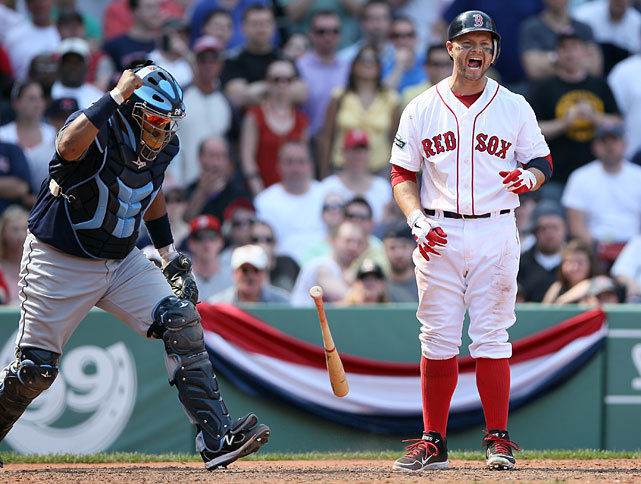 Cody Ross reacts after striking out with two men on in the bottom of the ninth as the Red Sox fell to the Rays 1-0 on Monday. Boston manager Bobby Valentine raised eyebrows when he questioned whether veteran third baseman Kevin Youkilis was emotionally invested in the game as previous years. The Red Sox are 4-6 after their first 10 games. (Elsa/Getty Images) POWER RANKINGS: Find out where Boston and Tampa Bay rank CORCORAN: Motivation should pave way to rebound for Youkilis