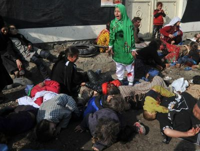 "Massoud Hossaini won the Pulitzer Prize in Breaking News Photography for this photograph that appeared in newspapers around the world last December. The image is from the aftermath of a suicide attack at shrine in Kabul attended by Shiites taking part in a religious ceremony. Via the New York Times Lens Blog, which spoke to Hossaini in December after publishing the photo:  ""Women were asking me, 'Help, help, help,'"" Mr. Hossaini said. ""I couldn't. I was recording and I was taking pictures."" One of the women who was holding a baby, called out for help — her other child had died. Another man lifted the child from the ground. But blood was pouring from its head. The man placed the child back on the ground and walked away. As Mr. Hossaini photographed, he realized he was weeping. When he looked down, he realized how badly his own hand was bleeding. He wrapped it with the cleanest piece of material he could find.  Hossaini works for Agence France-Presse. It is the organization's first Pulitzer."