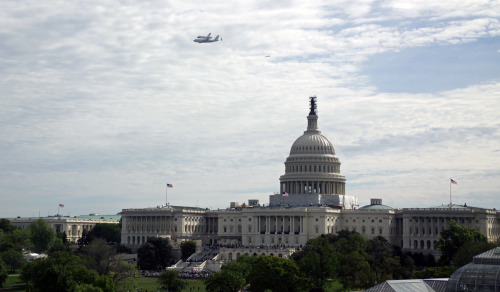 Discovery's Final Flight  The space shuttle Discovery flew over Washington D.C. this morning, perched atop a 747 transport plane. This was the shuttle's final flight, as it is being delivered to its final resting place at the Smithsonian Air & Space Museum. D.C. residents got quite the air show today, as shown by these photos. If you're jealous and you happen to live in NYC, keep your eyes open next week as the Enterprise, a never-flown shuttle prototype, makes its way to the west side of Manhattan to the Intrepid Sea, Air & Space Museum. It will be visible on a barge in the Hudson River and will be lifted via crane onto the aircraft carrier deck. West coast residents will have a chance later this year when Endeavour is flown out to Los Angeles for her final resting place. (images via Twitter @BarisOrnarli and @skenigsberg)