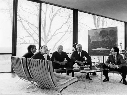 Andy Warhol, David Whitney, Philip Johnson, Dr. John Dalton, and Robert A. M. Stern in the Philip Johnson's Glass House. Photographed in 1964 by David McCabe, for The Glass House Conversations.