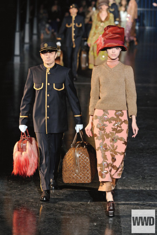 womensweardaily:  Fall 2012's Big Ideas A Girl, Her Valet and Her Bags: Louis Vuitton