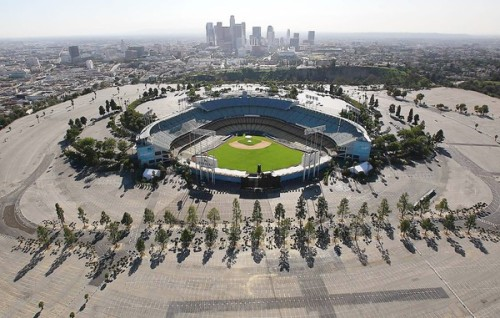 Developing Chavez Ravine is likely in play for new Dodgers owner: Real estate experts say the rich price Guggenheim Baseball Management paid for the team probably means it is looking to do more with the land surrounding Dodger Stadium than simply park cars. Photo: An aerial photograph of Dodger Stadium in November. Credit: Brian van der Brug / Los Angeles Times