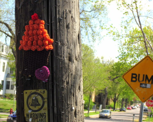 25th St Cupcake #yarnbomb In the middle of placing this I had to stop and refill my staple gun. The yarn gods smiled on me because after I stepped away, a cop car came down the street.