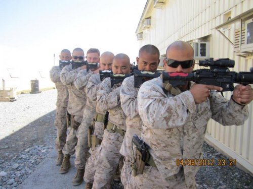 collegehumor:   Soldiers in Afghanistan Pose with Mustache Guns   In the practical art of war, the best thing of all is to look fancy.