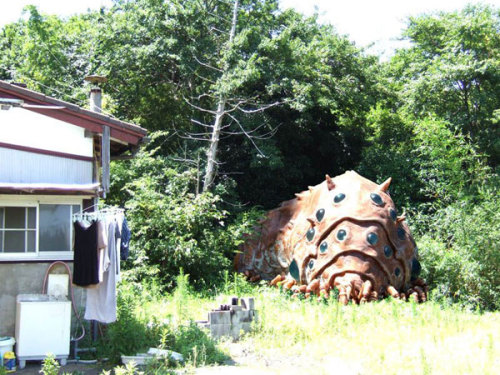 samehat:  A Ohmu from Nausicaä in the backyard of a Japanese home. Sadly I have no further info.