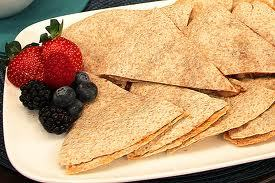 Banana Quesadilla Whether you do yoga, walk, spin, bike, run, or swim, you usually get hungry after activity. Many people reach for energy bars such as PowerBar, but with a little creativity, you can do a WHOLE lot better.   serves 2) 2 whole grain tortillas1 ripe banana1 tablespoon peanut buttera few chocolate chips (optional) Mash banana in bowl with potato masher. Spread peanut butter and banana on tortilla, add chocolate chips, and top with other tortilla. Warm in microwave for 20 seconds (depending on your microwave).  For 1/2 quesadilla = 230 calories, 6.7 g fat, 37 g carbohydrates, 6.6 g protein, 6.0 g fiber, 367 mg sodium, 4 PointsPlus