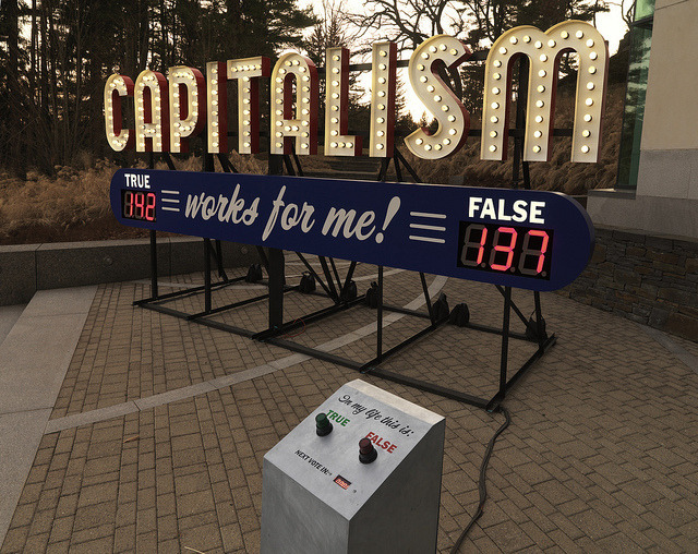 "Steve Lambert, Capitalism Works For Me! True/False, 2011. Photo courtesy of the DeCordova Sculpture Park and Museum.  The first in a series exploring the current state of major survey exhibitions, this interview with deCordova Biennial curators Abigail Ross Goodman and Dina Deitsch covers the team's approach to ""DIY curating"" and reinvigorating the regional biennial. Check back for a new interview each day this week…..Read More Here."