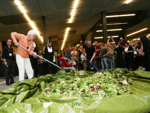I love performance art. And salads. interweber:  Make a Salad will be performed on the High Line in the Chelsea Market Passage, the semi-enclosed passageway on the High Line at West 16th Street. At 10:00 AM, the artists will begin preparing the salad ingredients on the upper-level of the passageway. (Salad ingredients will include enough locally-sourced escarole, romaine, frisée, carrots, cucumbers, onions, celery, and mushrooms for up to 1,000 people.) At 12:00 PM, the artists will toss the salad from the upper-level to the lower-level of the passageway, and then begin serving it to the audience at 12:15 PM. Make a Salad is free and open to the public. —High Line Art Performance: Alison Knowles, Make a Salad | The High Line (via Dorsey)