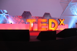 The big red on-stage TED gets the 'X' treatment to become TEDx