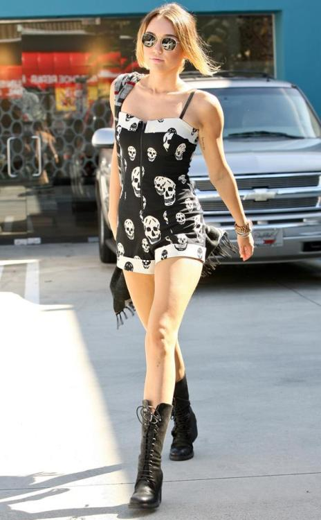 Miley Cyrus wears a skull romper after leaving the gym. Totally normal!