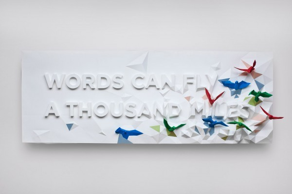 showslow:  This beautiful typographic poster made of folded paper was designed and constructed by Montreal-based designers Kyosuke Nishida, Brian Li and Dominic Liu for the Words Can Fly A Thousand Miles Project. The piece shows a number of origami cranes bursting through the surface of carefully crafted type.