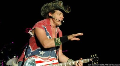 "thedailywhat:  Ted Nugent Drama of the Day: Ted Nugent, at the NRA convention Saturday:  ""If Barack Obama becomes the president in November, again, I will either be dead or in jail by this time next year.""  A Secret Service spokesman, responding accordingly:  ""We are aware of the incident, and we are conducting appropriate follow-up.""  DNC Chair Debbie Wasserman Schultz, going on the offensive today:  ""Mitt Romney must condemn Nugent's violent and hateful rhetoric immediately, as it has no place in our political discourse or this campaign.""  Romney spokeswoman Andrea Saul, forced to play defense:  ""Divisive language is offensive no matter what side of the political aisle it comes from. Mitt Romney believes everyone needs to be civil.""  Sigh. [ww]  Idiot. Or, as Obama might say (since he said so about Kanye): jackass."